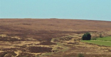 The ancient landscape of Llanllwni Mountain with the two iron age burial mounds on the sky line